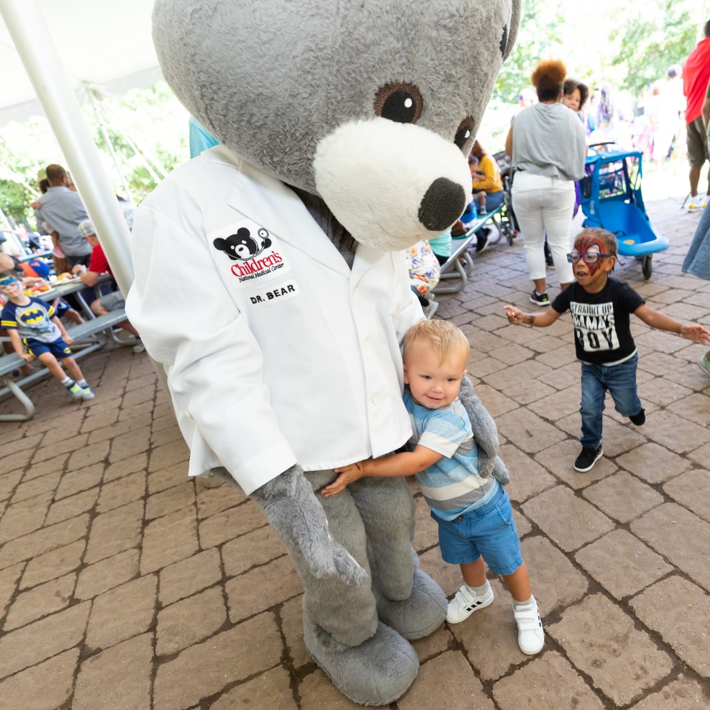 Child Hugs Dr. Bear