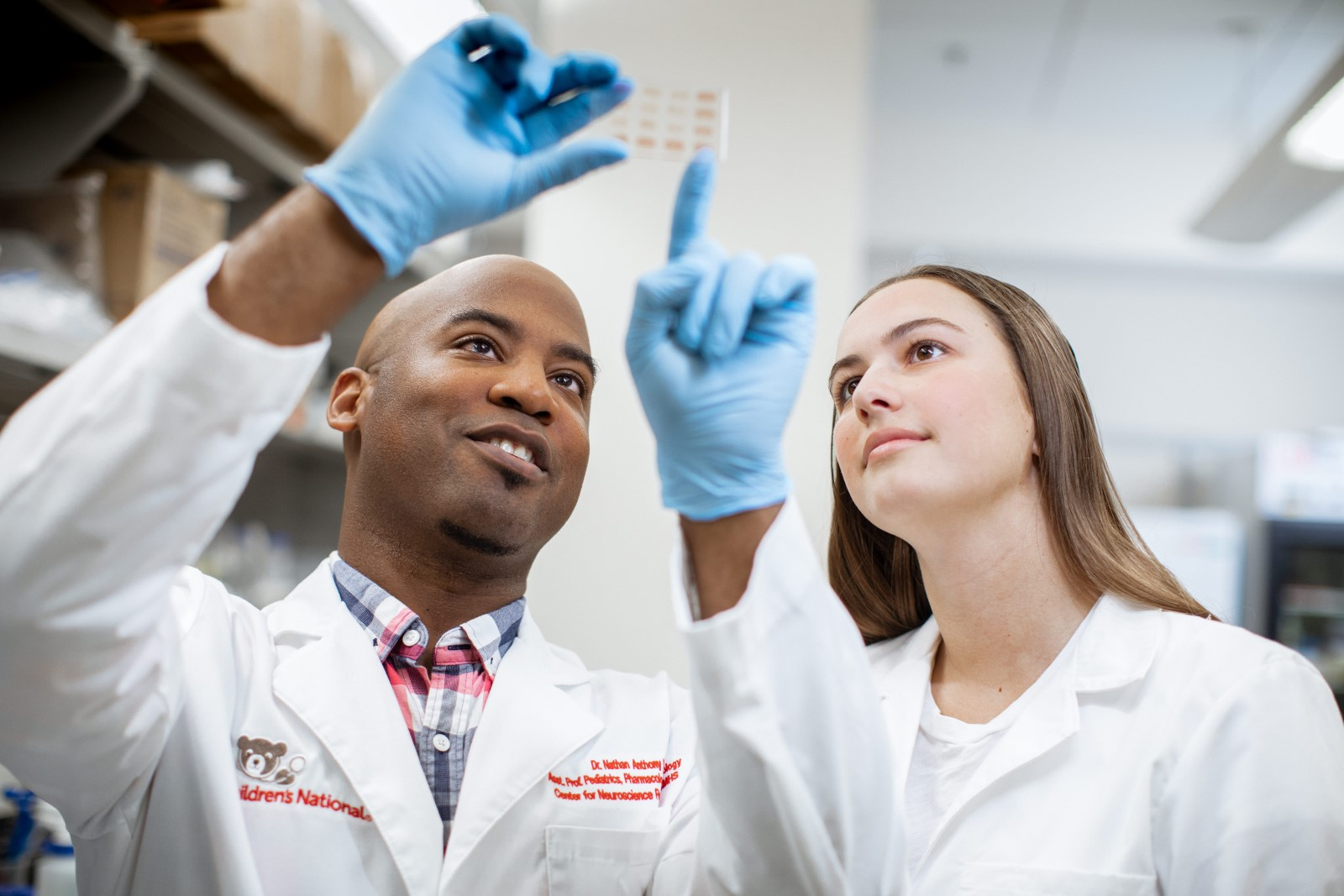 Two researchers looking at test results